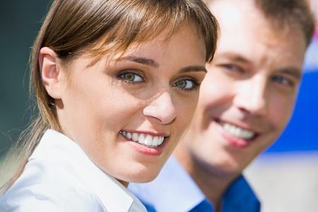 Face of business woman with charming confident smile on the background colleague photo