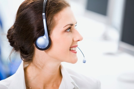 Beautiful business womant is smiling and looking away in an office environment photo