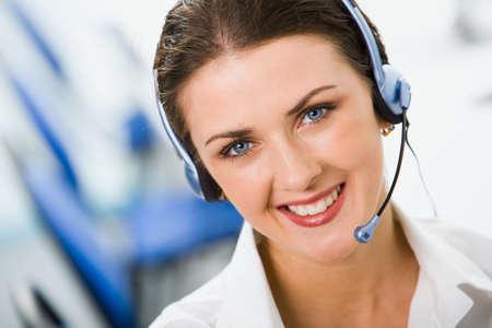 secretary phone: Portrait of friendly smiling female negotiator with marvelous blue eyes Stock Photo