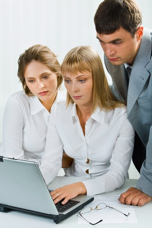 Confident specialist demonstrate a business project to her coworkers photo