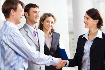 financial team: Business people are shaking hands confirming a sale  Stock Photo