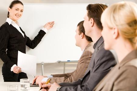 Businesswoman doing presentation on whiteboard at seminar Stock Photo - 8395664