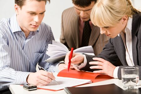 Portrait of business people pointing at a text of working document Stock Photo - 8395748