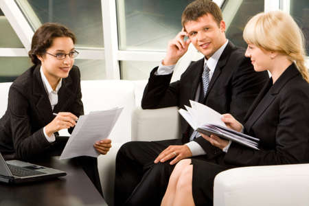 Portrait of three white collar workers discussing a new idea photo
