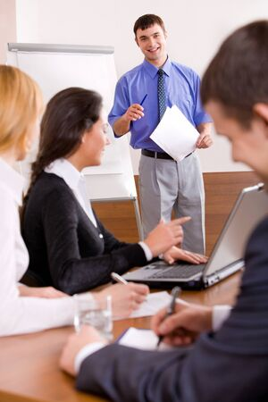 Businessman delivers oneself of a speech in the conference room photo