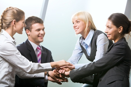 Business team putting their hands on top of each other Stock Photo - 8399692