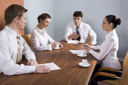 Group of young businessmen are discussing very important question Stock Photo - 8399664