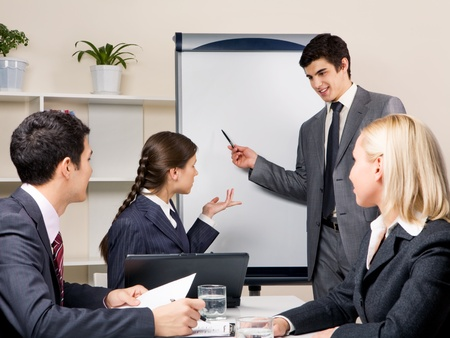 Photo of successful businessman sharing ideas by whiteboard and communicating with partners at presentation Stock Photo - 8399778