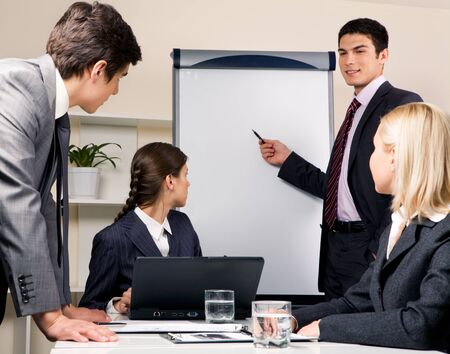 Photo of successful businessman reading lecture to his colleagues at presentation of new project photo