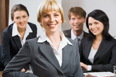 Female leader on the background of  her business team Stock Photo - 8400185