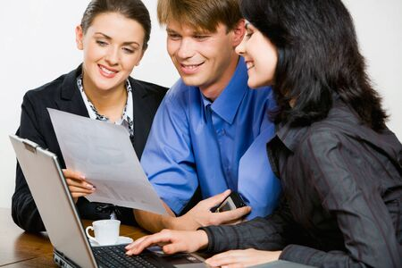 new strategy: Confident professional demonstrates new strategy to her co-workers Stock Photo