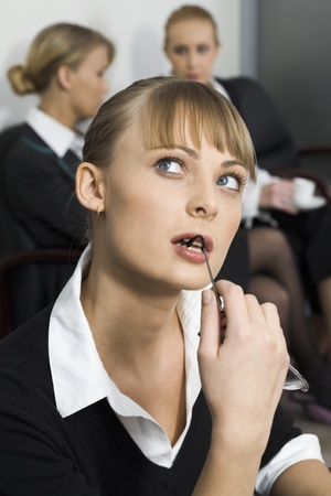 Cute blond woman is thinking over the situation photo