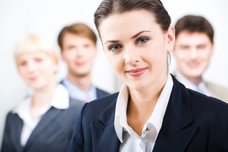 Photo of leader with her business team in the office Stock Photo - 8399913