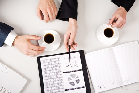 Above view of business people hands working with documents at briefing Stock Photo - 8405434
