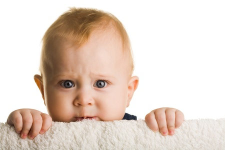 grandkids: Face of adorable baby peeping out of barrier over white background
