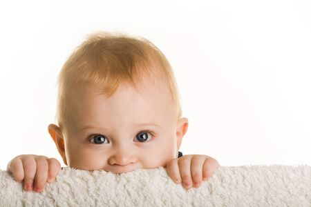 curious: Face of curious baby peeping out of board over white background Stock Photo