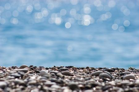 tejas: Close-up de guijarros de R�o sobre fondo de agua borrosa