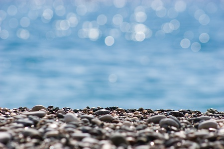 shingle: Close-up of river pebbles on background of blurred water Stock Photo