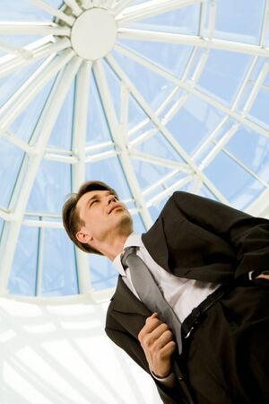 Below view of confident businessman in suit looking aside Stock Photo - 8401024