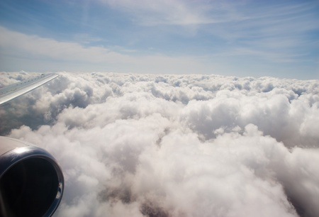 Close-up of fluffy clouds photographed from board of airplane photo