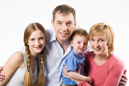Portrait of happy husband and wife with their children looking at camera Stock Photo - 8402631