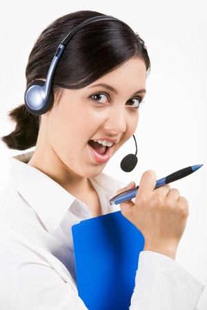 Image of successful professional holding pen in hand and looking at camera with smile photo