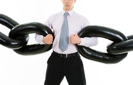 Powerful businessman holding sections of huge chain over white background Stock Photo - 8400527