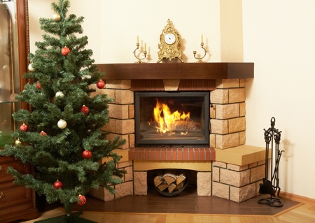 Image of house room with Christmas tree and fireplace in it photo