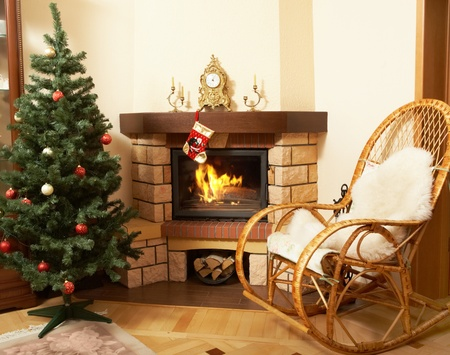 rocking chair: Image of house room with rocking-chair, Christmas tree, fireplace in it Stock Photo