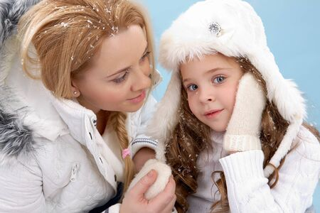 winterwear: Portrait of mother and her daughter in warm winter clothes Stock Photo