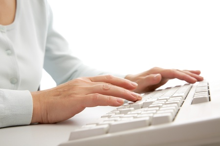 Macro image of female hands typing on keyboard Stock Photo - 8405433