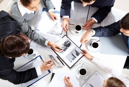 coffee meeting: Image of business team sitting at the table and discussing a new project  Stock Photo