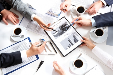 Image of hands of working businesspeople at meeting  photo