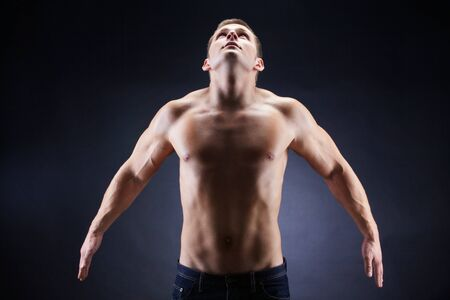 upwards: Image of shirtless man looking upwards in front of camera