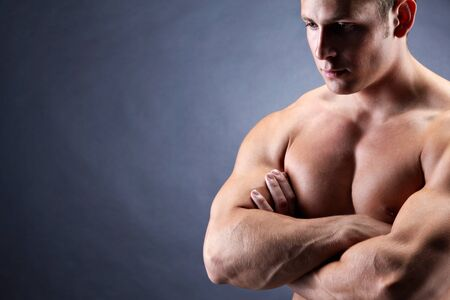 Image of shirtless man with crossed arms over dark background Stock Photo - 8405364