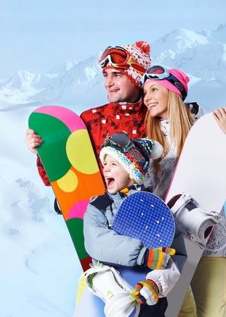 recreational sports: Portrait of happy family with snowboards on winter resort