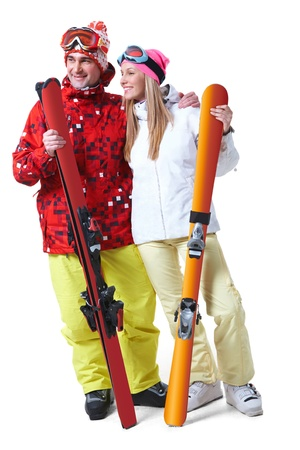 aside: Portrait of happy couple with skis in hands looking aside with smiles Stock Photo