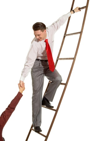 Image of confident businessman on ladder supporting man Stock Photo - 8400438