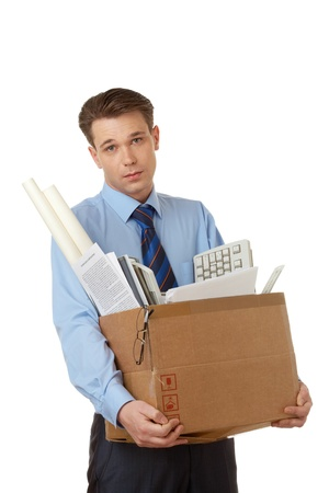 Portrait of businessman holding box with office stuff and looking at camera Stock Photo - 8400341