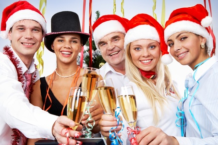 lacet: Portrait of smart colleagues with flutes of champagne celebrating Christmas Stock Photo