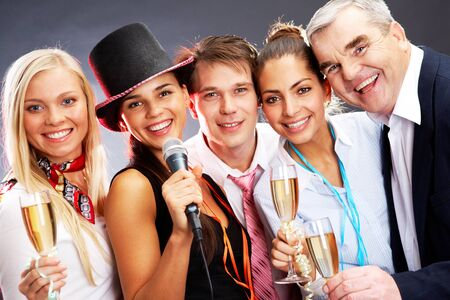 Photo of businesspeople with flutes of champagne celebrating Christmas photo