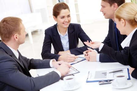 Image of successful partners looking at pretty employee while discussing business plan at meeting Stock Photo - 8402397