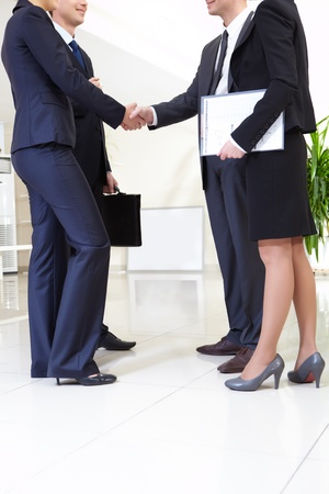 Image of business people handshaking after signing agreement Stock Photo - 8402627