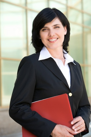 Image of pretty businesswoman looking at camera with happy smile photo