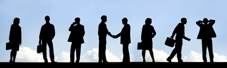 Outlines of business partners handshaking with several employees near by photo