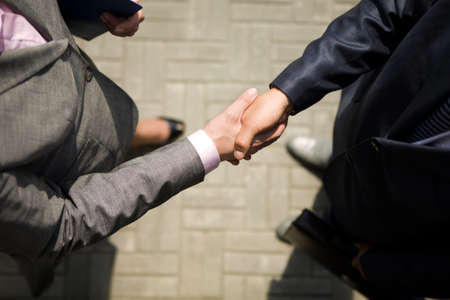 Above view of successful business partners handshaking after striking deal  photo