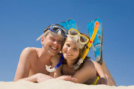 Portrait of cheerful couple in aqualungs looking at camera with smiles Stock Photo - 8435266