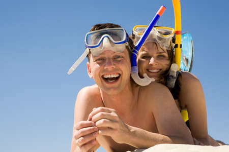 Portrait of cheerful divers lying on sand and enjoying themselves Stock Photo - 8435173