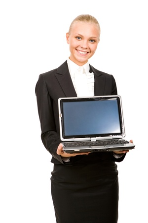 Portrait of successful business lady with open laptop in hands photo