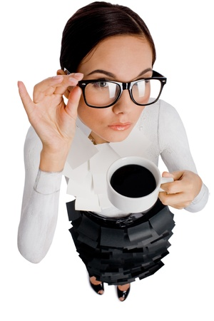 woman drinking coffee: Above view of pretty woman in eyeglasses drinking black coffee and looking at camera